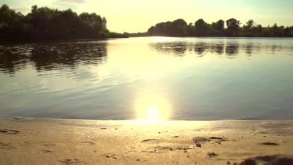 Fotoväggar - River in sunset. Beautiful Nature scene. Sandy Beach. Slow motion 240 fps, full HD 1080p
