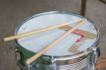 Old snare drum and drum sticks