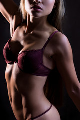 The slender figure of a woman in lingerie