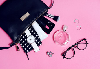 Wall Mural - Top view of set female accessories on pink flat lay