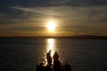 couple at a sunset in the Albufera lake, in Valencia