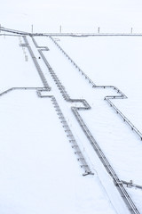 High angle view of pipeline on snowy field