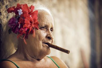 Close up of senior woman smoking cigar