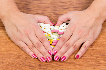 Treatment of diseases with modern methods. Homeopathic and chemicals. Various kinds of drugs in female hands.