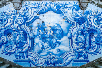 Religious scene in blue azulejos at the Remedios stairs in Sanctuary Nossa Senhora dos Remedios. Lamego, Portugal.