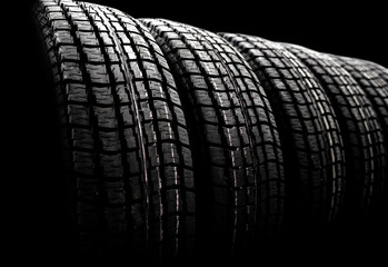 new winter tires in a row. Black and white photo with vignette