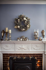 Christmas wreaths hanging on wall over fireplace