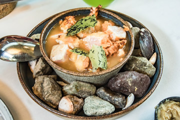 A Peruvian fish stew like no other, kept warm with surrounding hot rocks