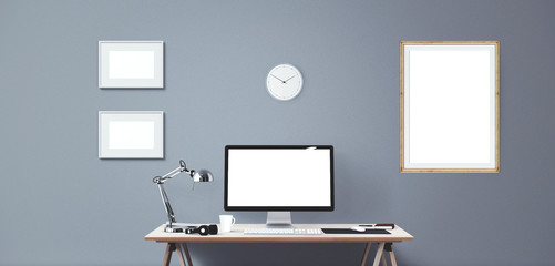 Computer display and office tools on desk. Desktop computer screen isolated. Modern creative workspace background