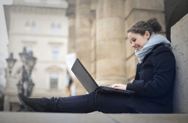 Girl with laptop on the floor