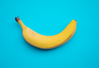 banana on blue pastel background. minimal concept.