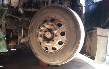 Truck dirty wheel is on repairing in truck shop