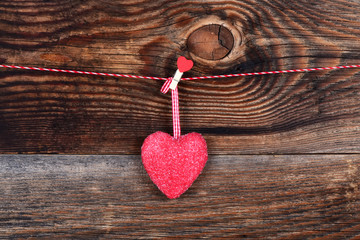 Red heart on a beautiful old wooden background as love concept for valentines day