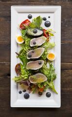 Nicoise tuna salad with activated charcoal
