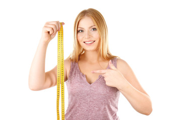 Young woman with measuring tape on white background