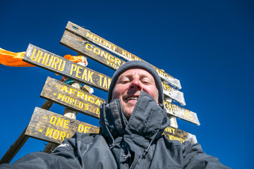 Hiker on the top of Africa - Uhuru Peak, Mount Kilimanjaro, Tanz