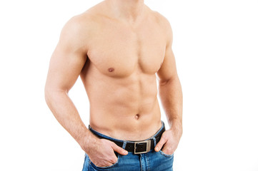 Muscular young man wearing jeans Isolated on white background.