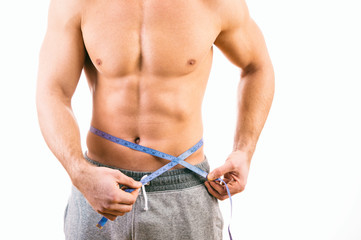 Male torso and blue tape measure on white background
