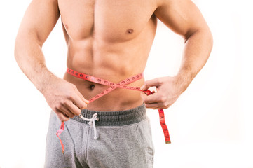 Male torso and red tape measure on white background