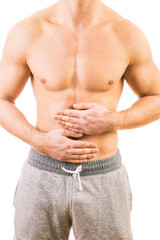 Man with stomach pain over white background