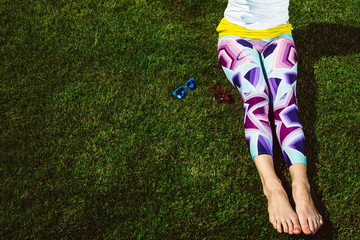 girl in colourful leggings sitting