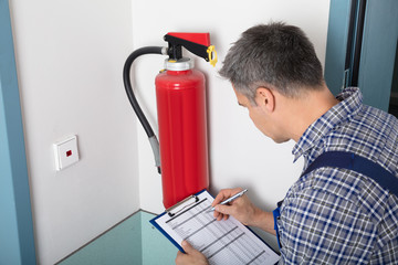 Professional Checking A Fire Extinguisher