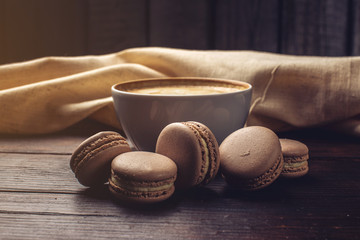 Flavored coffee cappuccino with macarons and cinnamon. The perfect Breakfast