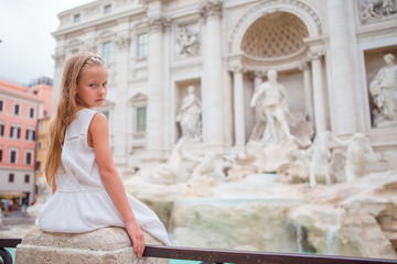 Adorable little girl background Trevi Fountain, Rome, Italy. Happy toodler kid enjoy italian vacation holiday in Europe.