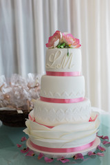 Beautiful wedding cake with pink ribbons