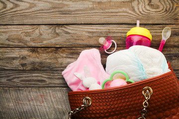 Mother's handbag with items to care for child