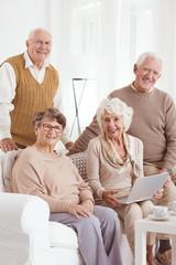 Senior friends and laptop
