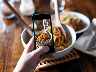taking photo with smartphone of spaghetti dinner