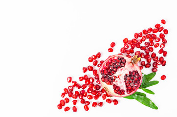 Pomegranate fruit and green leaves.