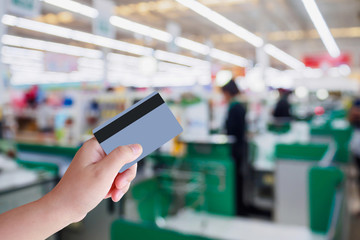 paying using credit card at supermarket checkout cashier