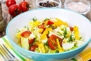 Fresh vegetable salad with olive oil