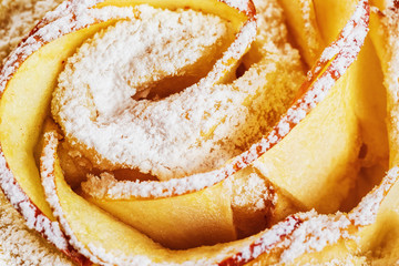 Closeup image of fresh twisted bakery with sweet sugar powder.