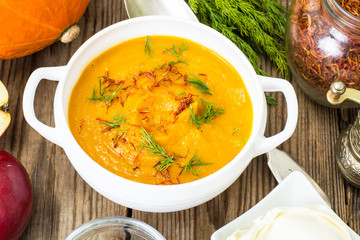 Pumpkin soup with curry, saffron and cheese balls