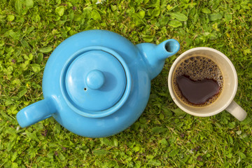 Blue teapot and cup with tea