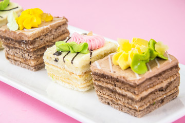Sweets Cream Cakes on Plate