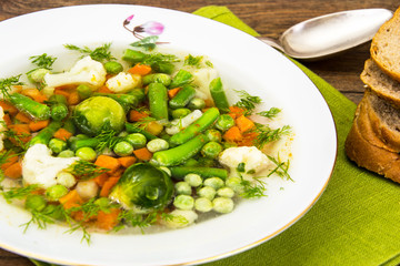 Soup with Cauliflower, Brussels Sprouts, Green Beans, Peas, Carr