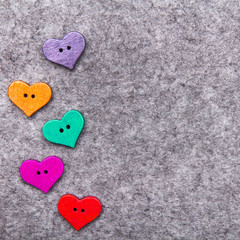 Wooden hearts on gray felt background, copy space