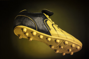 Black - yellow soccer shoe