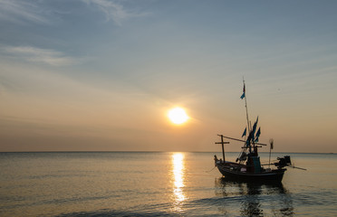 Fishing boats in the morning at sunrise.