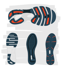 four sneaker soles on grey background