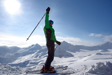 Skier on the top of ski slope