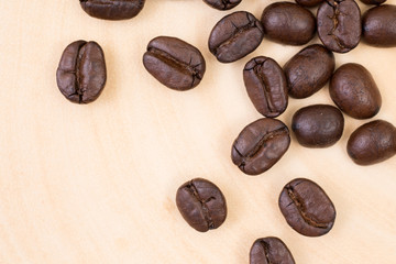 Top view of roasted coffee bean on wood texture background