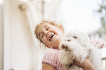 Happy girl playing with dog