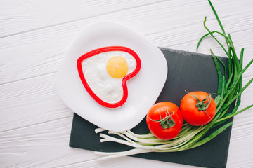 valentine day.romantic breakfast.fried egg and vegetables