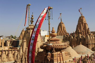 Flags and detail reliefs on rooftops of Jain temple in Jaisalmer,Rajasthan