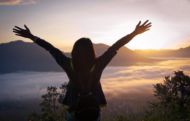 successful woman hiker open arms on mountain